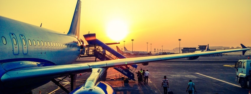 Photo of outside plane at sunset for Travel Insurance BC