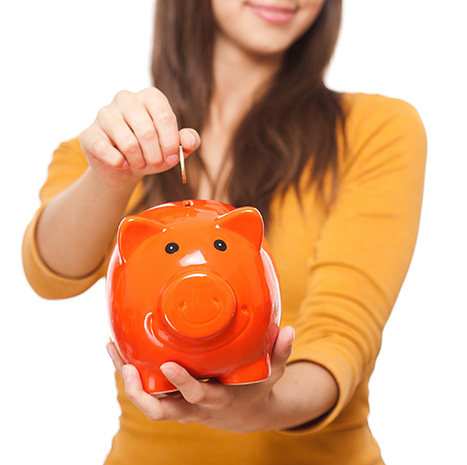 Woman in orange with piggy bank